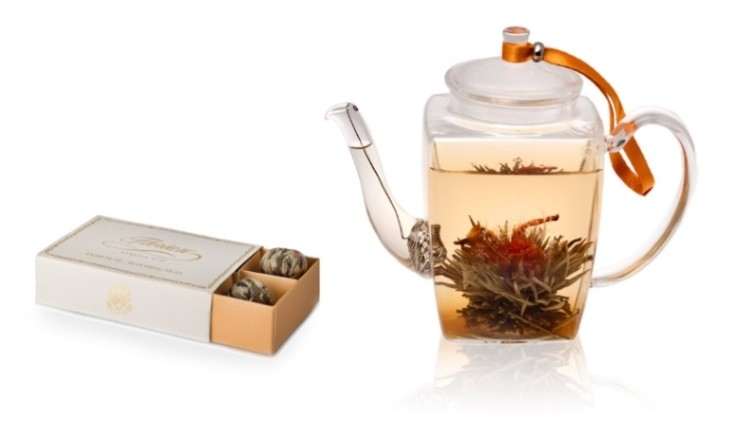 set of blooming teas and glass teapot